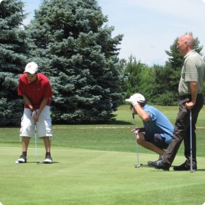 Teammates line up a putt