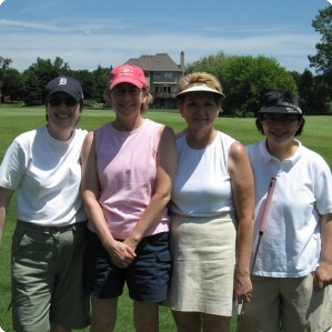 Golfers pose during the action