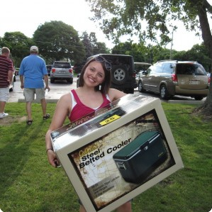 Raffle winner carries off her cooler